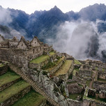Panoramic view of Machu Picchu surrounded in matinal fog, Cusco
